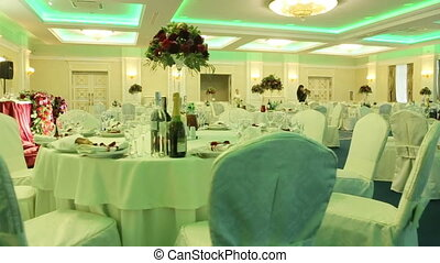 Served for banquet tables in a luxurious interior of restaurant hall. Camera movement in slow motion