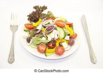 Served fresh vegetable salad on white background