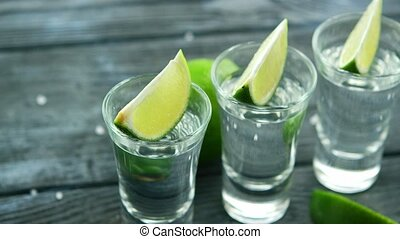 Served glass shots with tequila - Row of glass shots with...