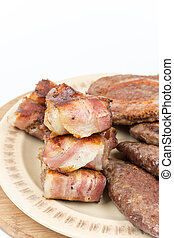 Served grilled meat on the plate over white background