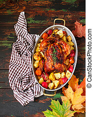 Served roasted Thanksgiving Turkey with vegetables on wooden background