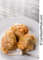 Served sarma in the plate above grey granite table background