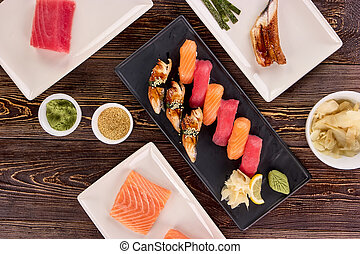 Served sushi with side dish in restaurant.
