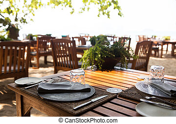served table at open-air restaurant on beach