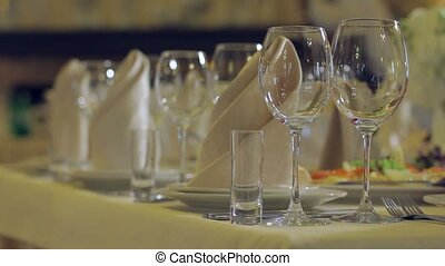 Banquet in the restaurant. - Served table. Glasses on the...