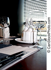 Served table in restaurant interior closeup
