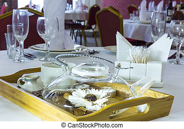 Served table in restaurant with teapot