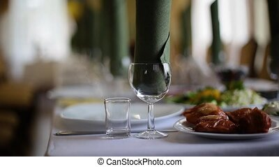 Served table with dishes and glasses for wine.