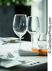 Served table with wine glasses in a restaurant