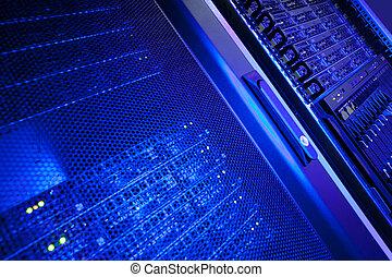 Server rack cluster in a data center (shallow DOF; color ...
