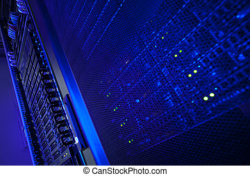 Server rack cluster in a data center (shallow DOF; color ...