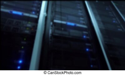 Server rack in the data center. View from below. Blue tinting. Motion Camera.