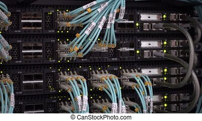 Server Room with blinking lights and vivid optical cables. -...