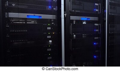 Servers in data center. Servers racks close up in Modern data center. Cloud computing datacenter server room. Motion camera