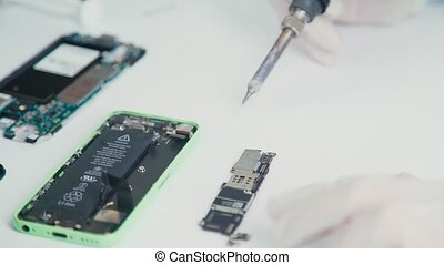 Cell phone disassembled into components: Li-ion mobile phone...