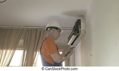 Service man to clean air conditioner in Room