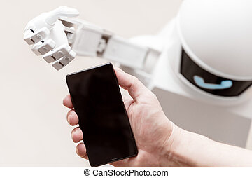 service robot is reaching a smartphone