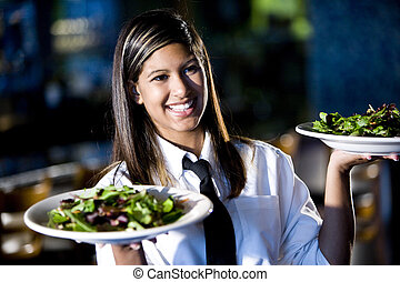 Service with a smile - Hispanic waitress serving two plates ...