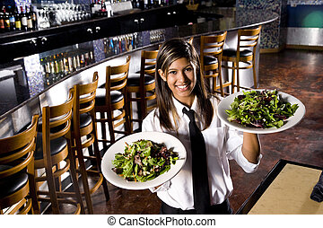 Service with a smile - Hispanic waitress in restaurant...