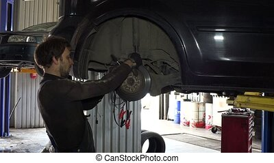 service worker man repair automobile brake system.