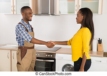 Serviceman And Woman Handshaking - Young Serviceman And...