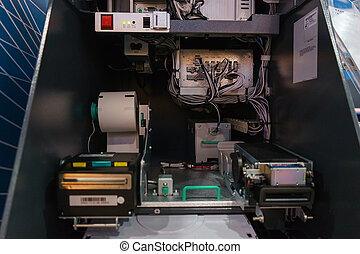 Internal parts of the ATM. The ATM is open for preventive maintenance of the equipment.