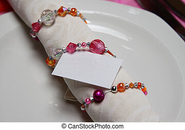 Serviette in a crystal serviette ring with a blank card
