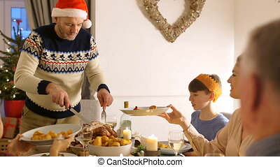 Serving Christmas Dinner - Mature man is serving his family...