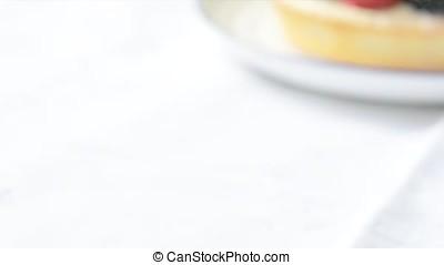Serving Fruit Tart - Serving tempting fruit tart with...
