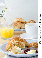 Serving of Croissant at a Continental Breakfast Table -...