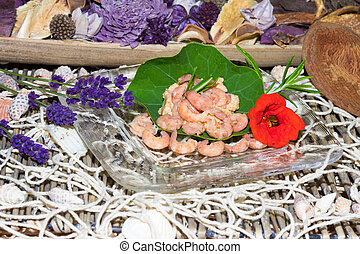 Serving of gourmet shrimps with herbs