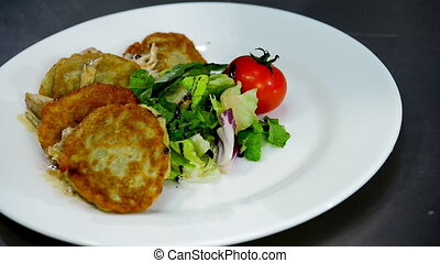 serving of potato pancakes on a plate