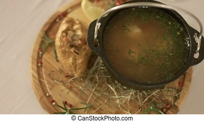 Serving of soup in the bowler hat in restaurant