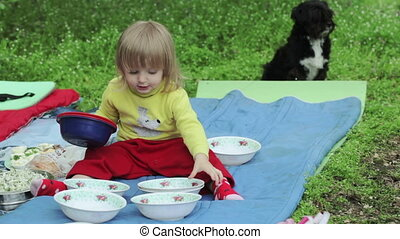 Serving picnic - Girl child is served picnic table on spring