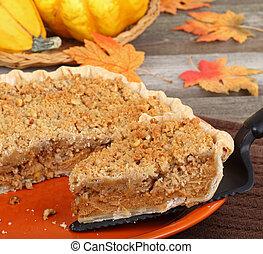Serving Pumpkin Pie - Slice of pumpkin streusel pie being ...