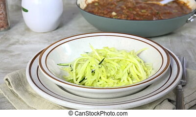 Serving sauteed zucchini noodles - Serving hot zucchini...