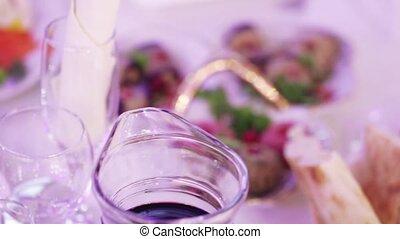 Serving table on banket - Waiter serves a festive table