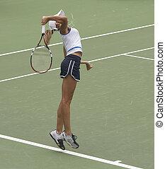 Serving - Tennis player serving