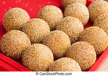 Sesame ball is China delicious food, wrap bean paste in ...