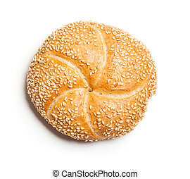 Bread roll covered with sesame seeds, typical German breakfast food. Studio shot, cutout, isolated on white background.