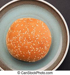Sesame bun on a rustic plate