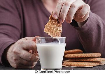 Sesame cookies, male dunking cookies in milk