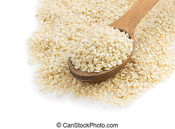 sesame seed in spoon on white