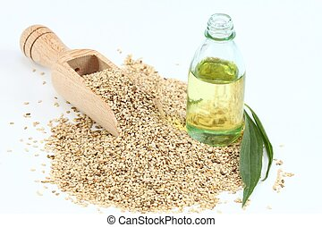 Sesame seeds and oil on white