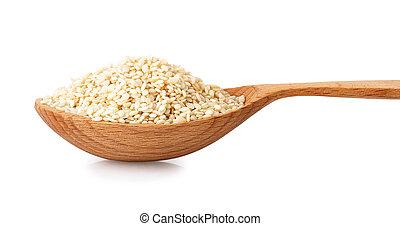 sesame seeds in spoon