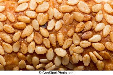 sesame seeds on a bun. macro