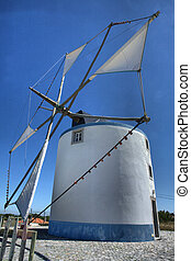 Traditonal windmill in the countryside from Sesimbra, Portugal
