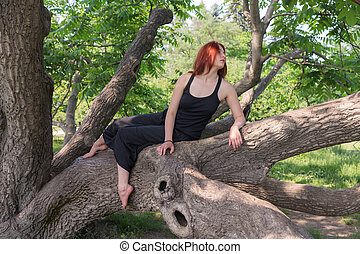 sesnsual girl on a tree