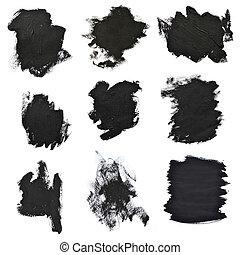 Set black brush strokes on white paper