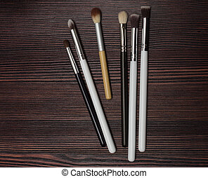 set brush on a wooden background